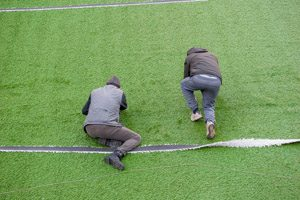 Preparation football field with artificial turf